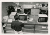 Photograph of man using catalog at Central Library 1984