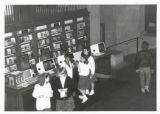 Photograph of school girls in front of catalog at Central Library